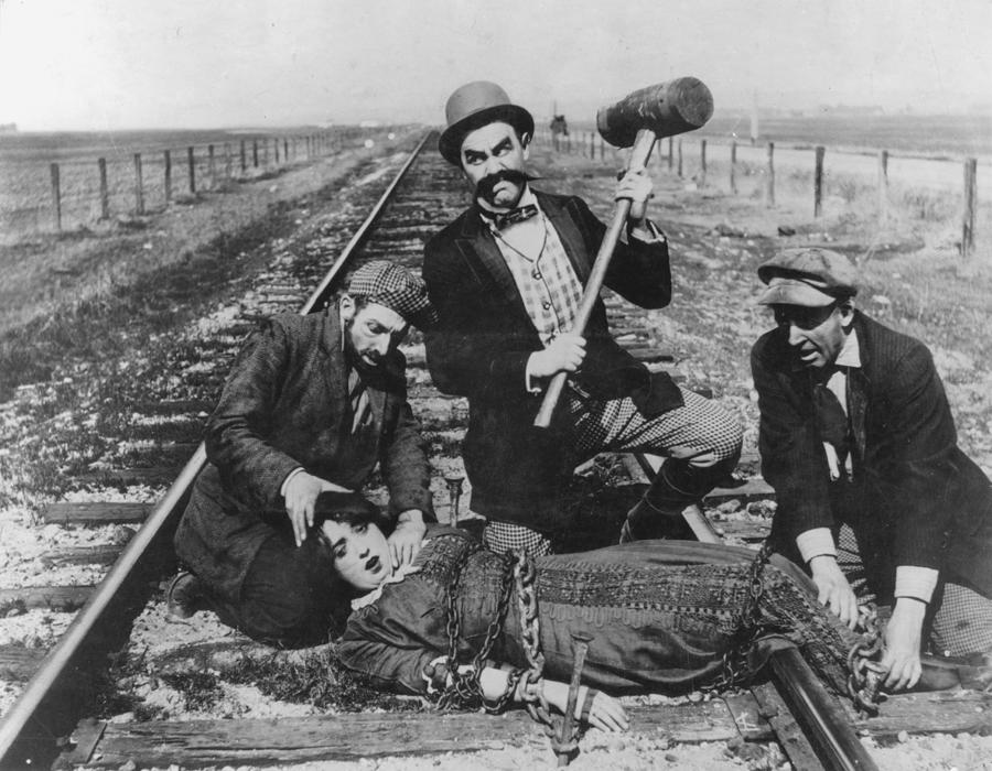 Barney Oldfield's Race for a Life (1913) Keystone comedy starring from l–r) Al St. John, Ford Sterling, Hank Mann, Mabel Normand (chained to railroad track), Mack Sennett (not pictured). silent film parody