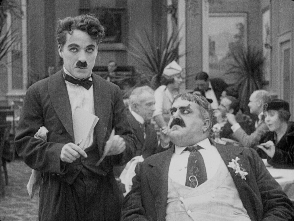 Charlie Chaplin and Eric Campbell in The Rink (1916) UK BFI Blu-ray screenshot