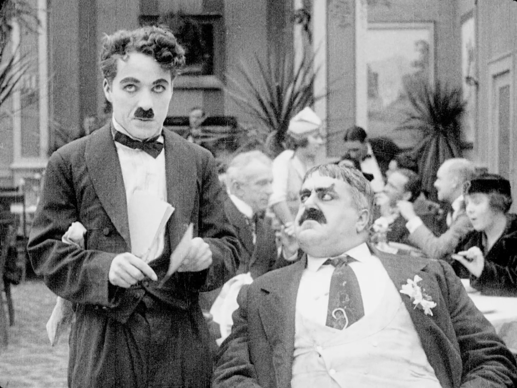 Charlie Chaplin and Eric Campbell in The Rink (1916) US Flicker Alley Blu-ray screenshot