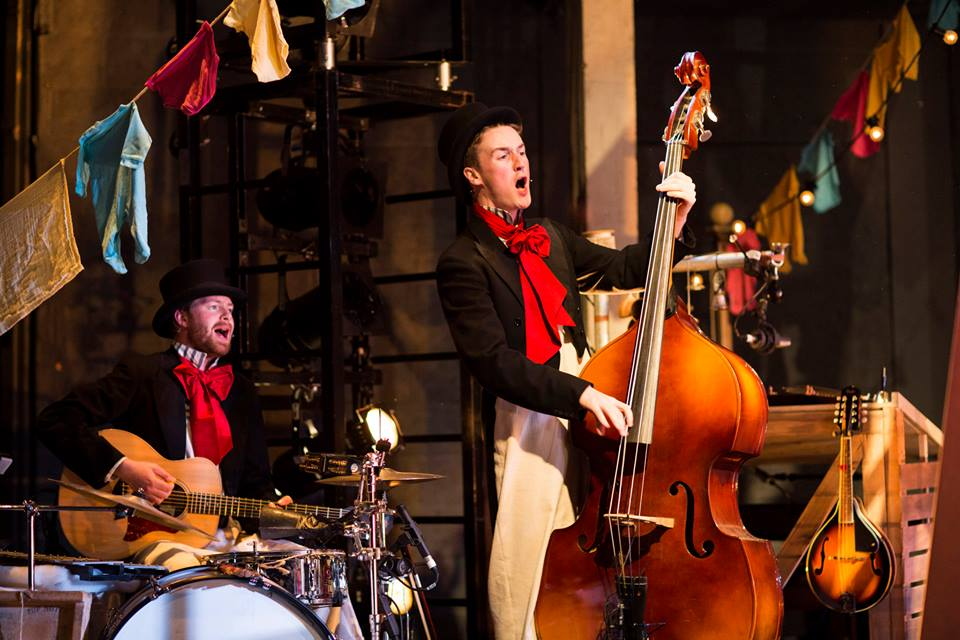 Seamas Carey (right) strumming on a double bass