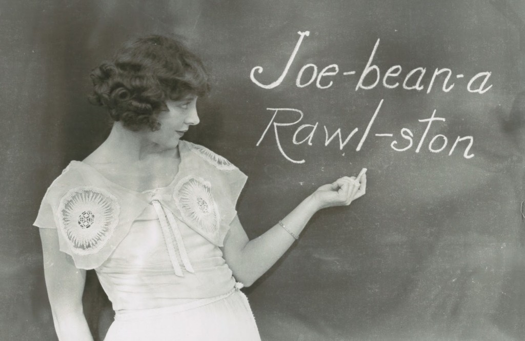 Jobyna Ralston, silent film actress and Harold Lloyd's main leading lady, writing her name phoenetically on a blackboard
