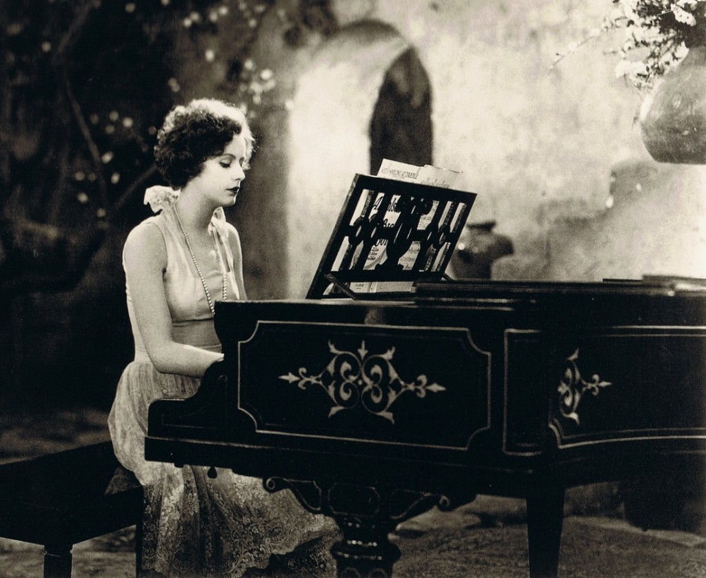 Greta Garbo playing a piano in Torrent (1926), cropped