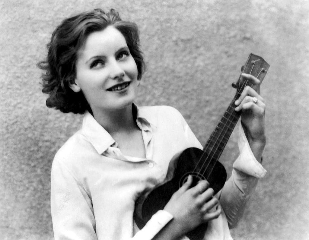 Greta Garbo playing a ukelele in Torrent (1926)
