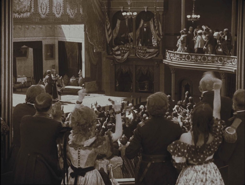 The Birth of a Nation (1915) BFI Blu-ray screenshot, Ford's Theatre, with the audience cheering Abraham Lincoln just prior to his assassination