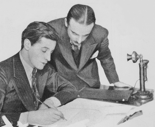 Ivor Novello signs his contract with Gainsborough Pictures under the watchful eye of Michael Balcon (c.1926)