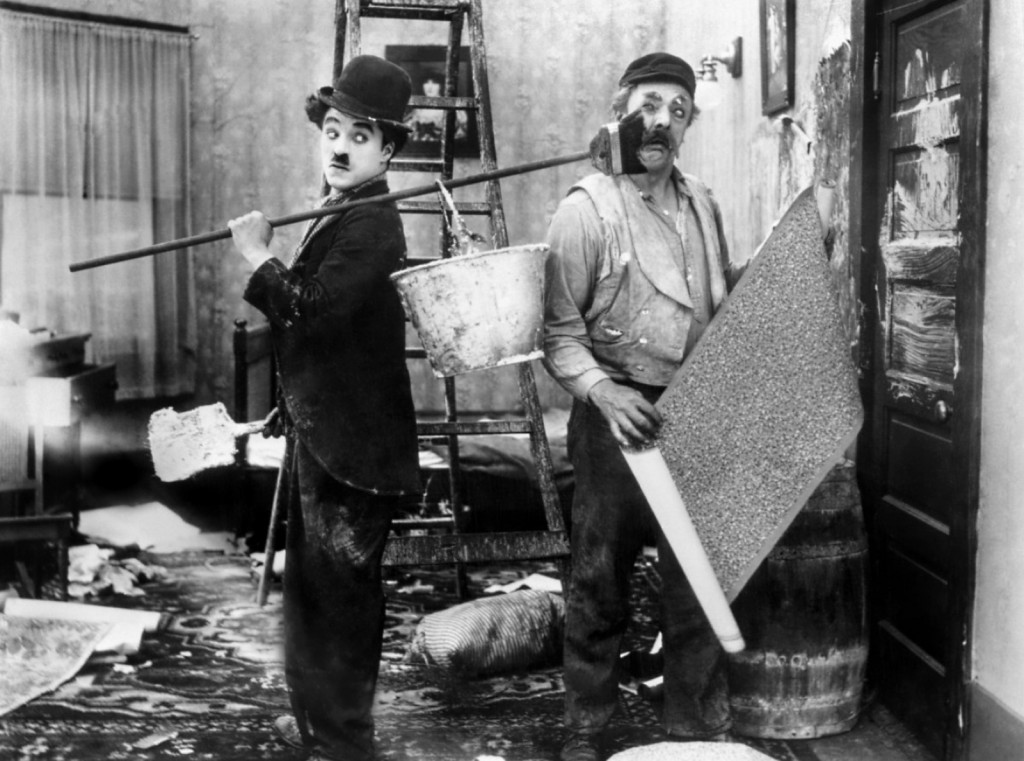 Charlie Chaplin and Charles Inslee in His New Job (1915)