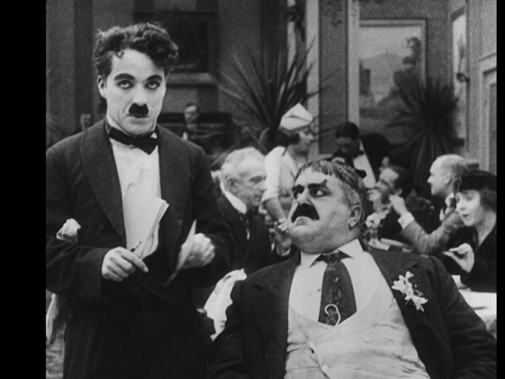 Charlie Chaplin and Eric Campbell in The Rink (1916) Spanish Divisa Blu-ray screenshot