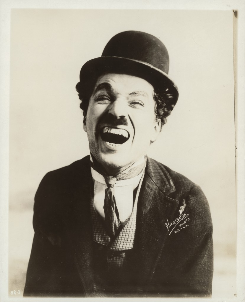 Charlie Chaplin laughing during his time with Mutual Films, circa 1916, by Fred Hartsook