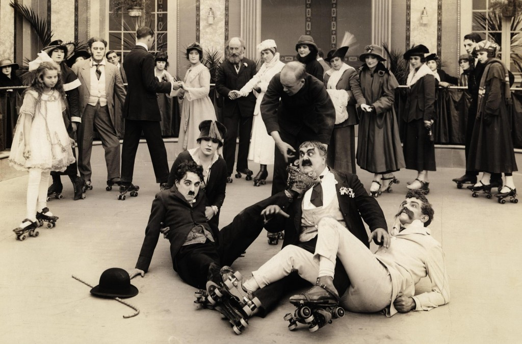 The Rink (1916) on the floor – (L-R) Charlie Chaplin, Edna Purviance, Eric Campbell and Albert Austin, cropped