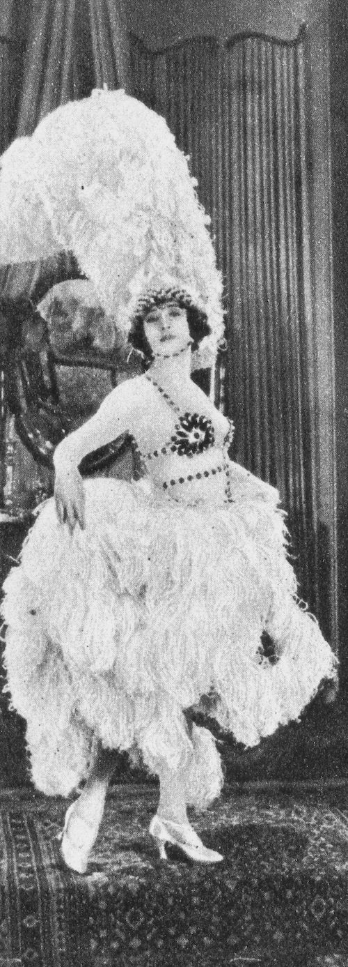 Betty Compson wearing a feather dress in Woman to Woman (1923). There are 200 ostrich feathers and 1,000 pearls in that Dolly Tree creation!