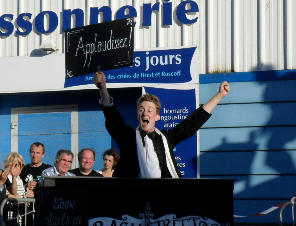 Seamas Carey prompts a French audience, in typically inimitable British style, during Bash Street Theatre's production of The Strongman (2012)