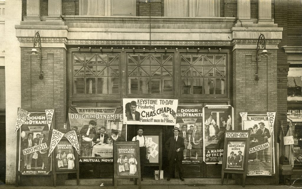 Cinema with Charlie Chaplin Keystone films display, 1914