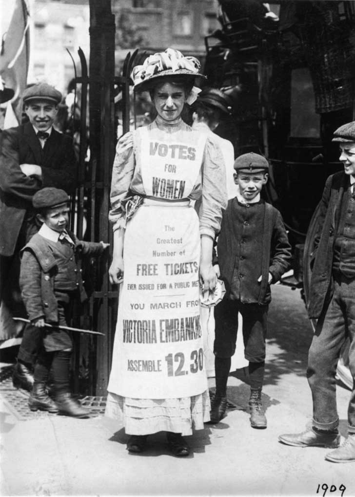 A young suffragette advertises a London march and rally, c.1909