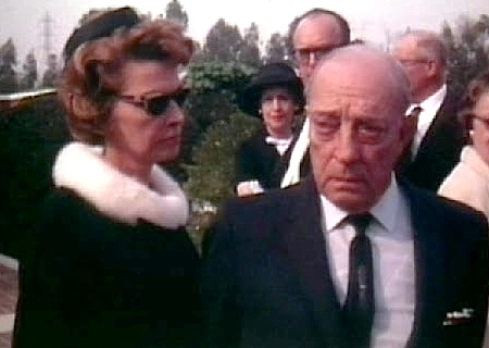 Buster Keaton and his wife Eleanor at Stan Laurel's funeral