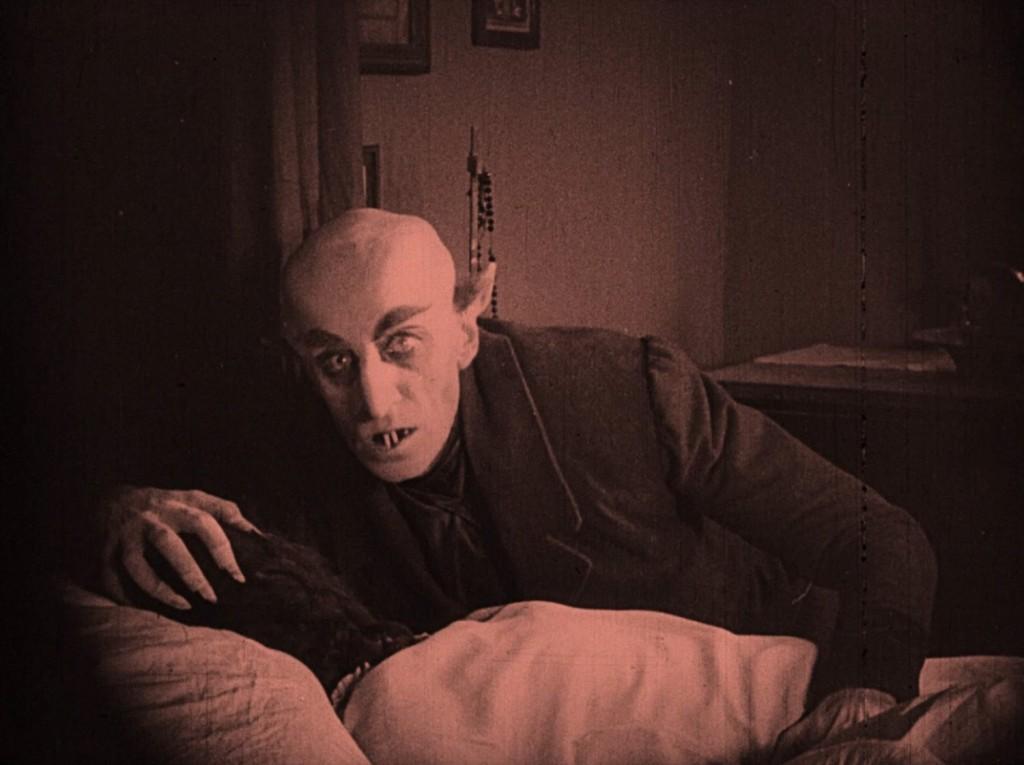 Nosferatu (1922) Max Schreck as Count Orlok feasting on his victim