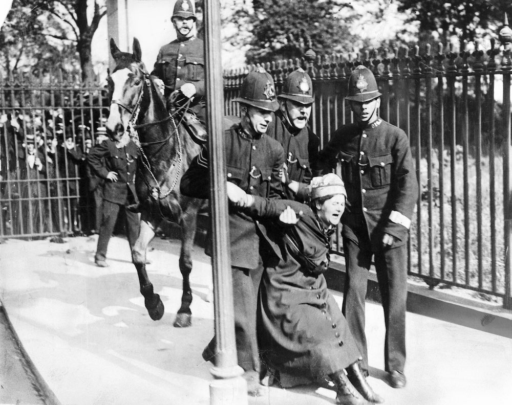 Campaigning suffragette being restrained by policemen, 5 July 1910