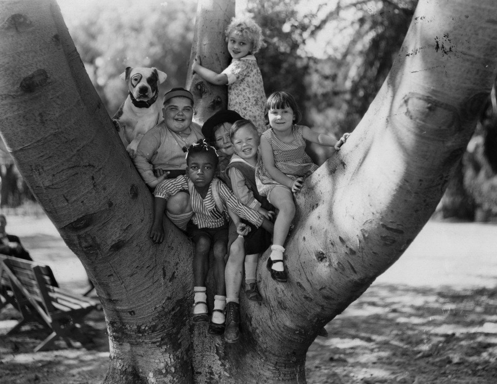 Jean Darling (standing) and the rest of Our Gang in a tree