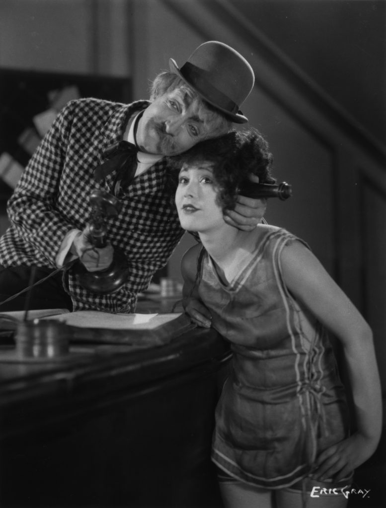 Donald Calthrop and Chili Bouchier in Shooting Stars (1928), telephone