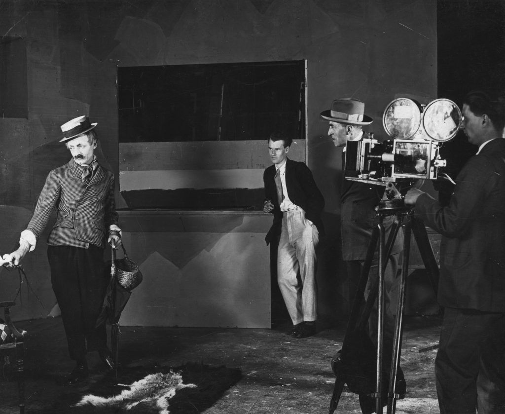 Donald Calthrop (L), Anthony Asquith, A.V. Bramble and cameraman on the set of Shooting Stars (1928)