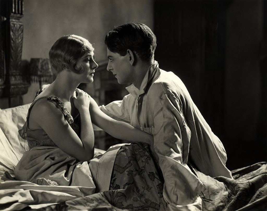 Isabel Jeans and Robin Irvine on a bed in Easy Virtue (1927, dir. Alfred Hitchcock)