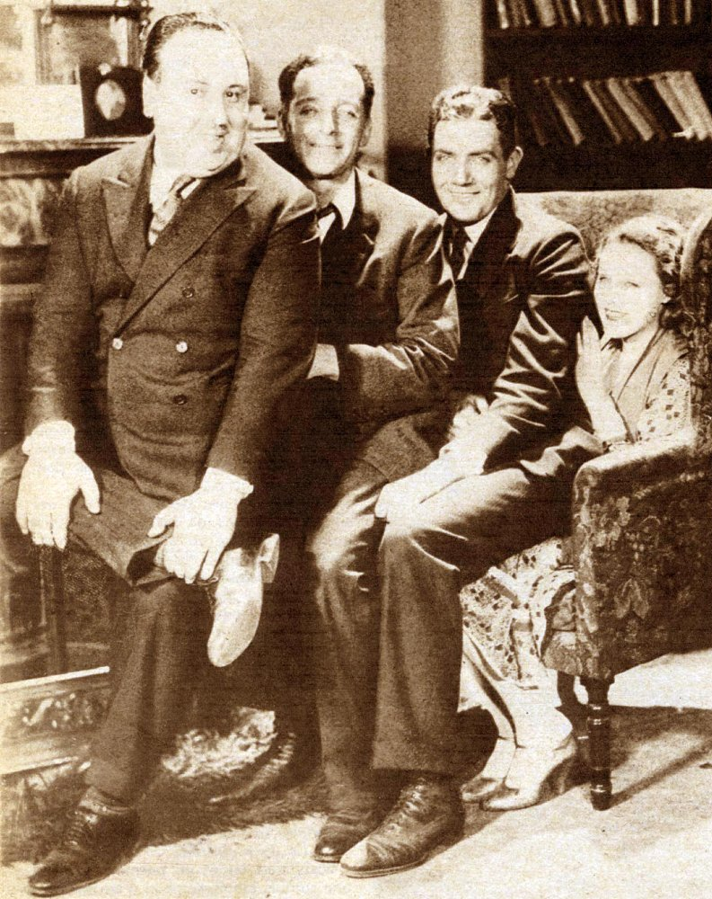 L-R: Alfred Hitchcock, Donald Calthrop, John Longden and Anny Ondra on the set of Blackmail (1929)