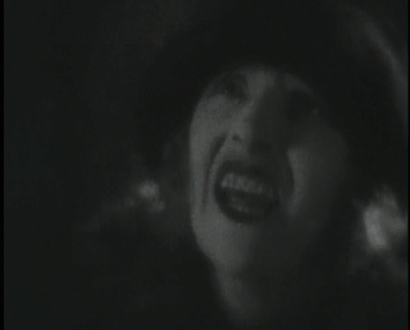 Horror hides in the shadows: Eve Gray is stretched and cropped in The Lodger (1926, dir. Alfred Hitchcock). US St. Clair Vision bootleg DVD screenshot.