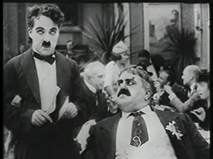 Charlie Chaplin and Eric Campbell in The Rink (1916) US Brentwood public domain DVD