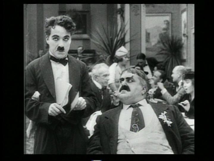 Charlie Chaplin and Eric Campbell in The Rink (1916) US Image DVD