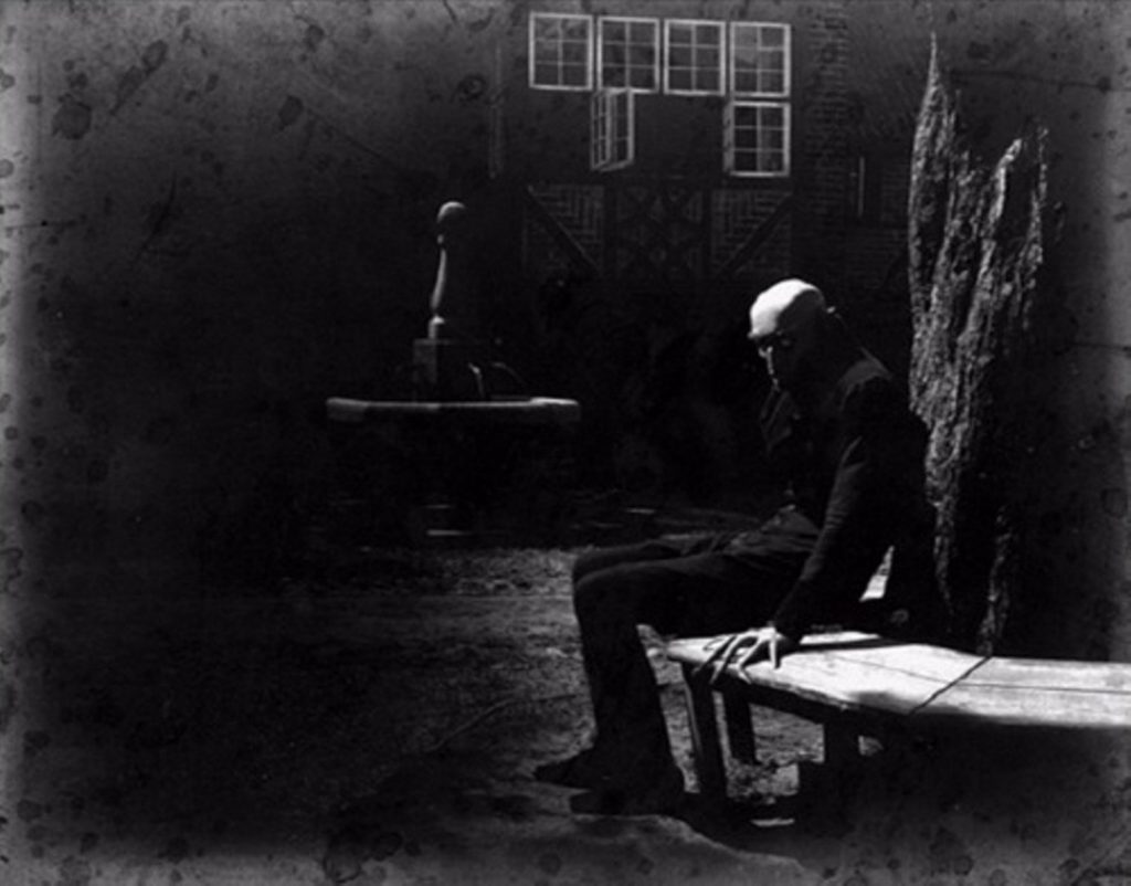 Max Schreck as Count Orlok, resting between takes on the set of Nosferatu (1922)