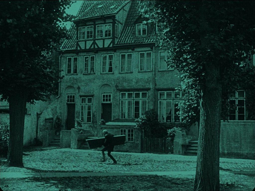 Max Schreck as Count Orlok in Nosferatu (1922) UK Eureka-Masters of Cinema Blu-ray, carrying coffin
