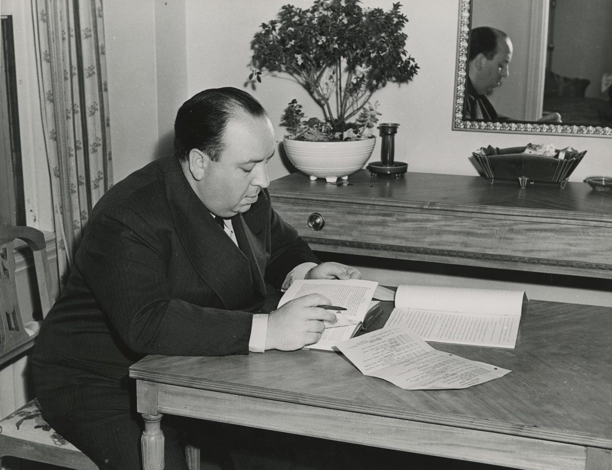 Alfred Hitchcock reading a script, c. 1940