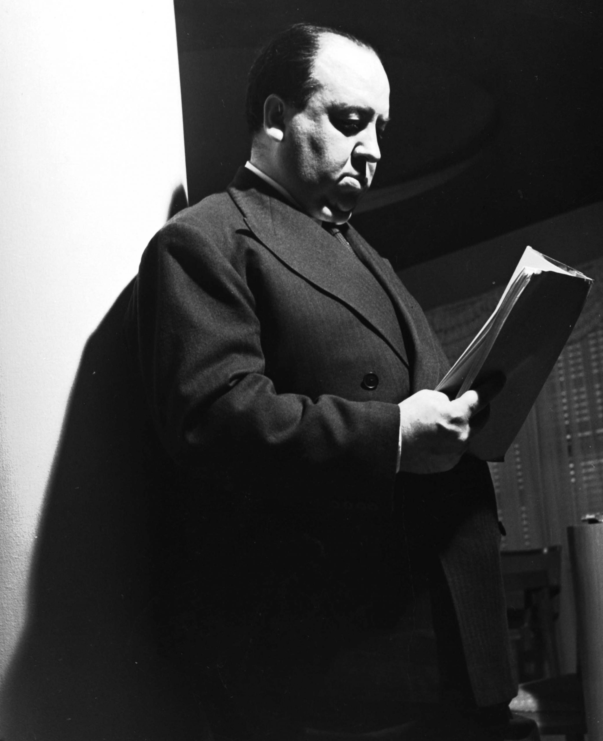 Alfred Hitchcock reading the script for Rebecca (1940)