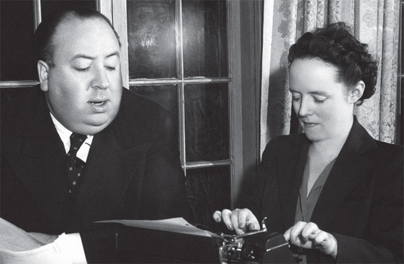 Alfred Hitchcock and Alma Reville with typewriter